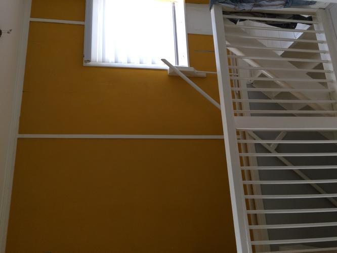 Behangen wand trap naar boven werkspot