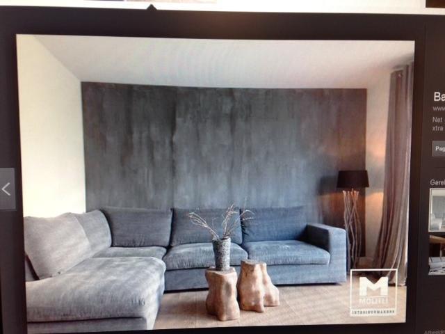 Muur woonkamer verven - Werkspot
