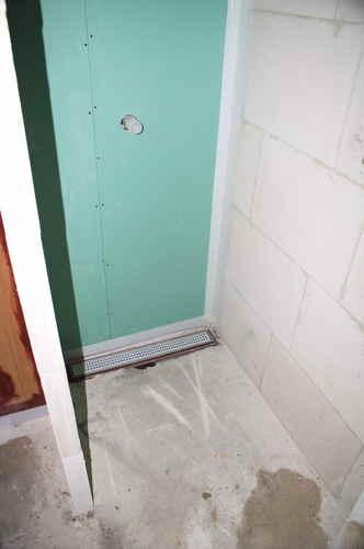60x60 op vloer +wanden badkamer + vloer hal - Werkspot