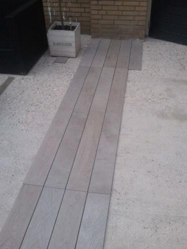 Tegels lijmen op beton bouwmaterialen for Vijverfolie lijmen op beton