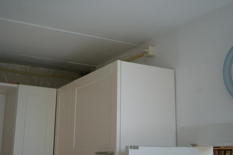 Koof boven keukenkastjes maken werkspot for Zelf keukenontwerp maken