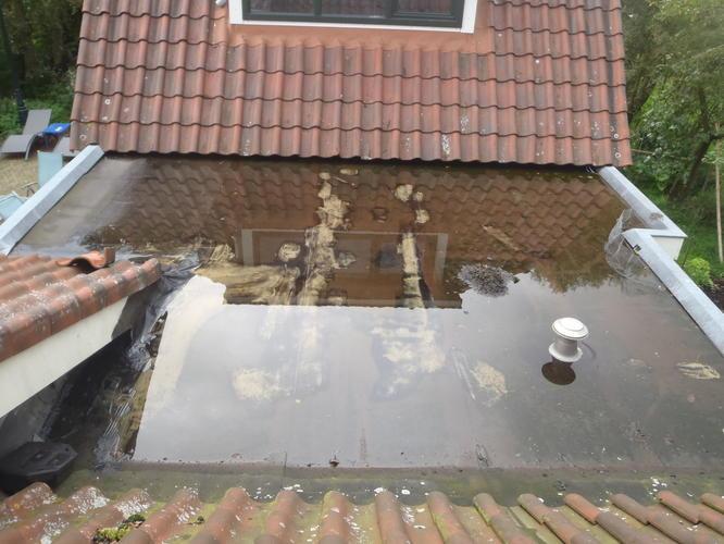 Afschot plat dak herstellen