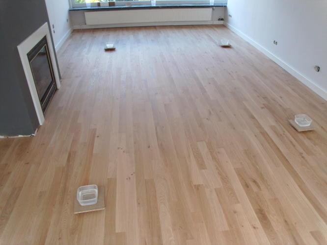 Schuren tapis vloer traditioneel parket werkspot