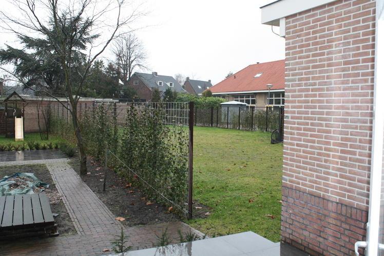 Tuin loungebank eettafel schutting werkspot - Hoe dicht terras ...