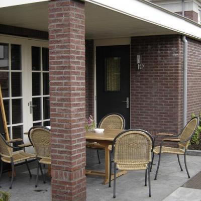 Veranda bouwen werkspot - Veranda met stenen muur ...