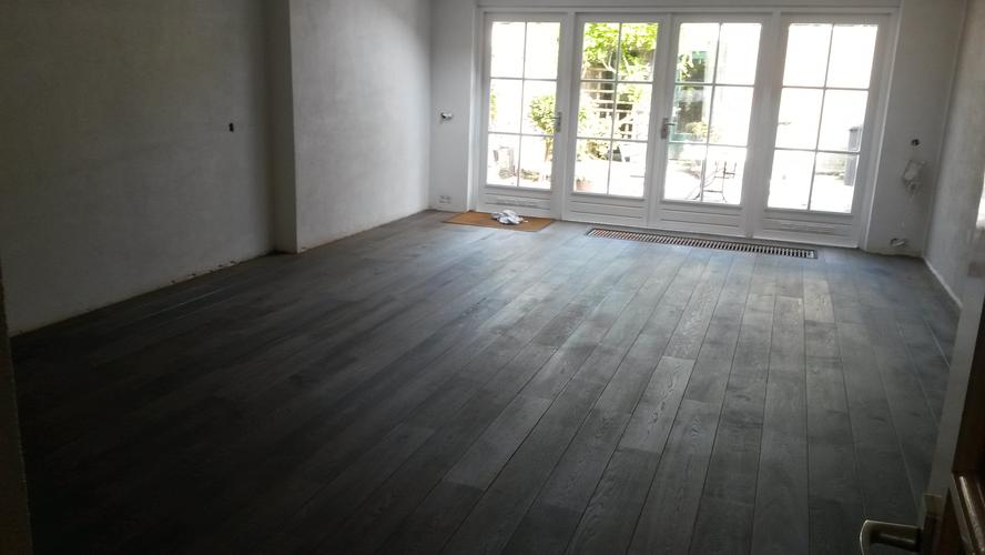Plinten aanbrengen in woonkamer en hal (ongeveer 31 meter) - Werkspot