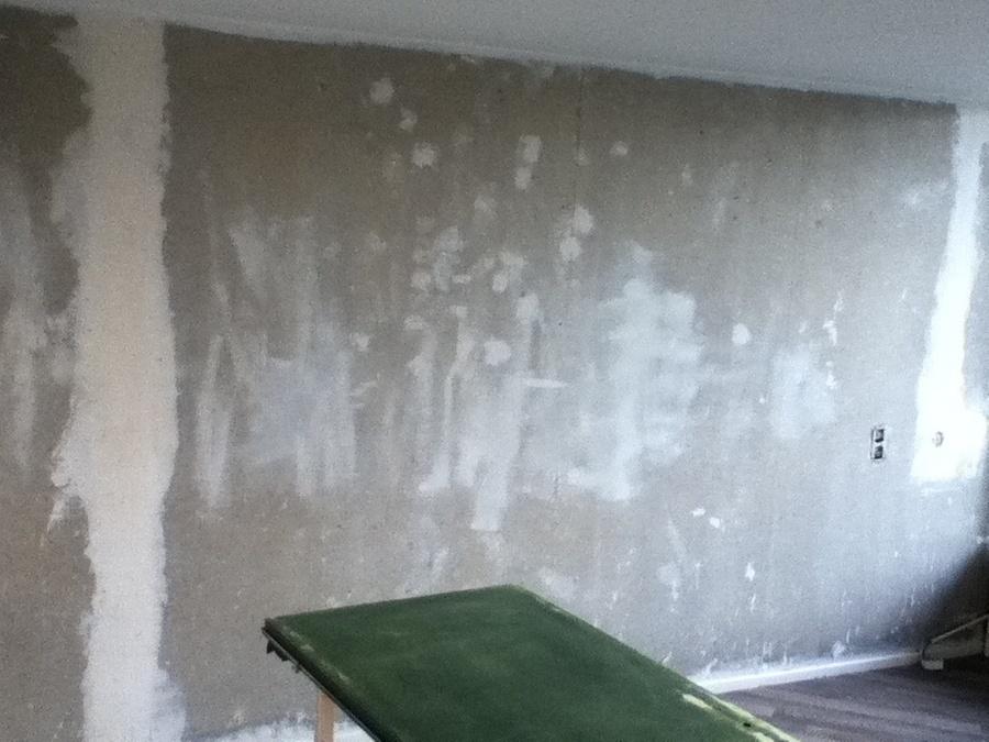 Betonnen muur verven