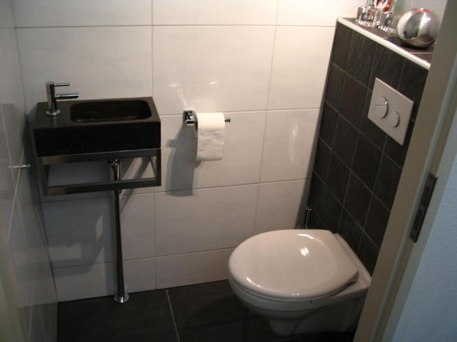 Wc verbouwen slopen tegelen hangend toilet wastafel plaatsen