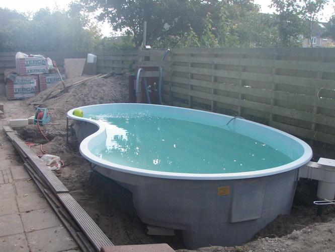 Stukje terras rond zwembad aanleggen werkspot