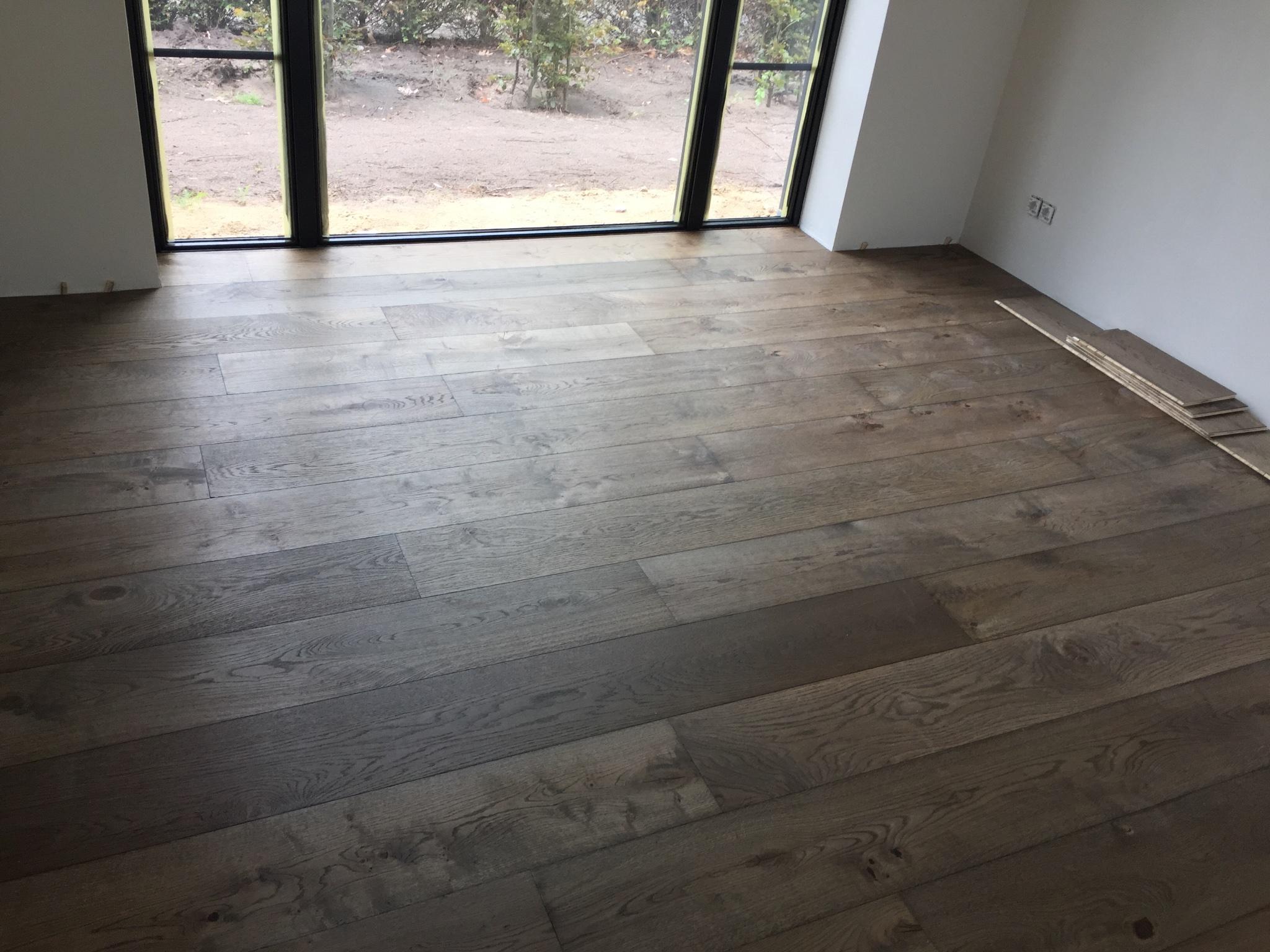 Houten vloer leggen lamel parket op vloerverwarming werkspot