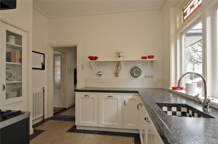 Eerst vloeren dan keuken houten vloer met vloerverwarming uipkes