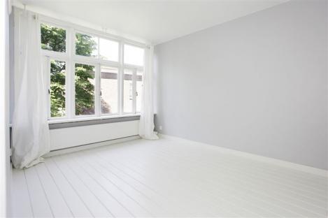 Houten vloer wit schilderen