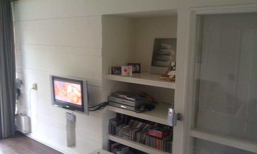 Wand woonkamer glad stucen werkspot for Wand woonkamer