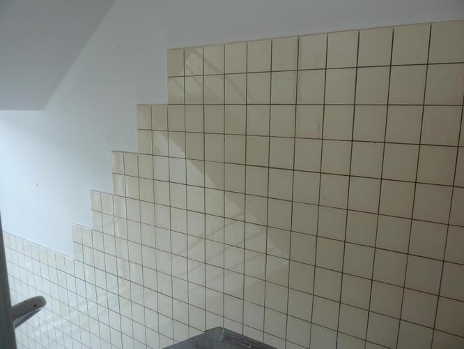 tegels verwijderen, muur stucen en verven - Werkspot
