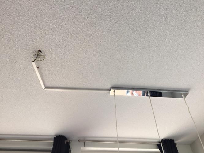 Lamp boven eettafel ophangen (boren is nodig) - Werkspot
