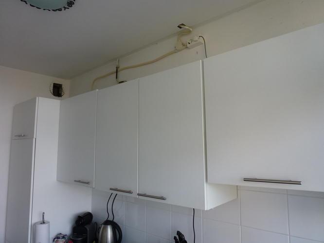 Afzuigkap aansluiten en dichtmaken bovenkant keukenkastjes   Werkspot