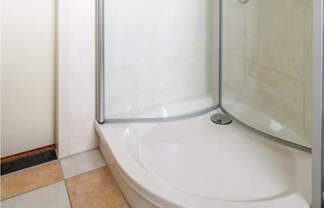 Grindvloer badkamer - Werkspot
