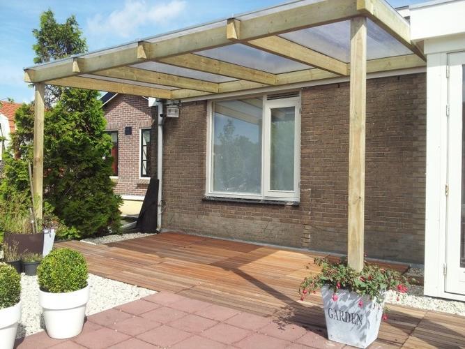 Terrasoverkapping van hout aan schuur werkspot for Bouwtekening veranda eigen huis en tuin