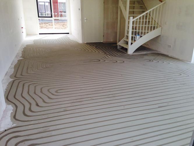 Egaliseren gang, keuken en woonkamer vloer - Werkspot