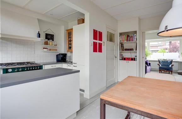 Houten vloerplanken woonkamer en keuken (30 m2) verwijderen - Werkspot