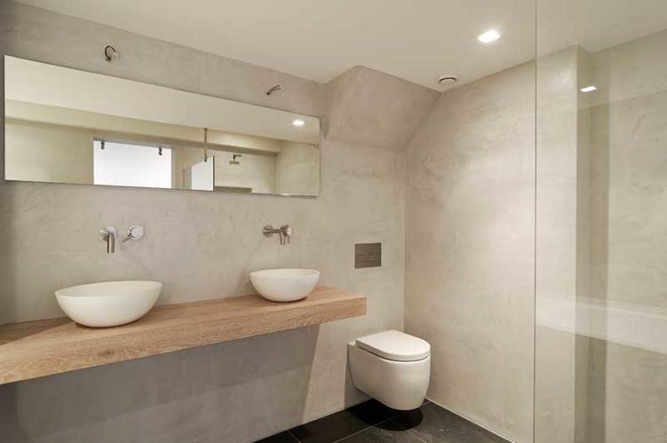 Beton cire betonstuc in de badkamer werkspot for Wanden nieuwbouwwoning afwerken