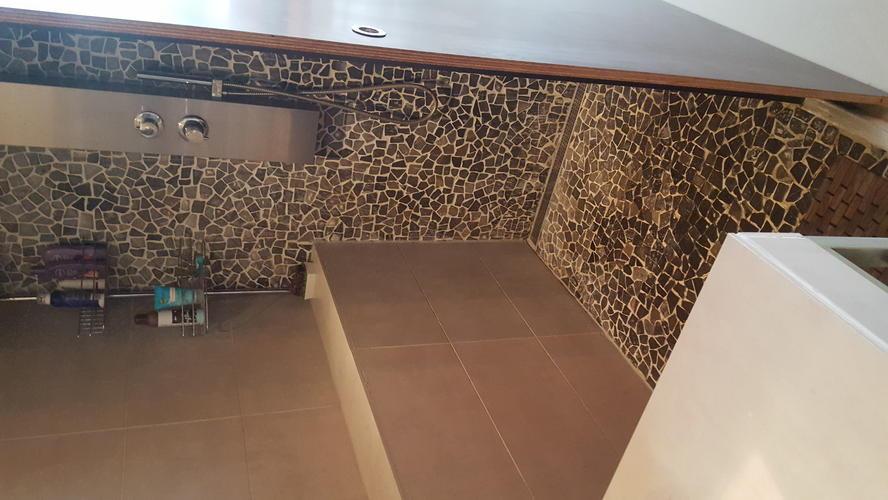 Badkamer vloer en muur betegelen Amsterdam - Werkspot