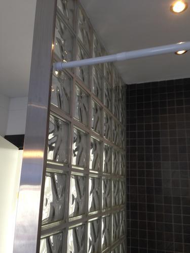 Glazen bouwstenen muur vervangen door een glazen douchewand - Werkspot