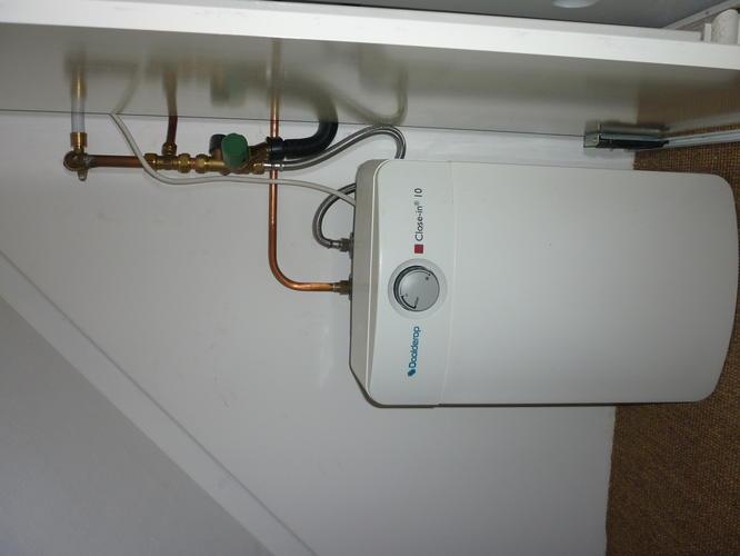 Aansluiten kraan wasbak op boiler kraan afvoer wasmachine