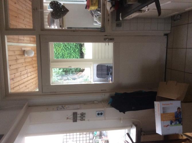 Serre aanbouwen en doorbreken woonkamer werkspot