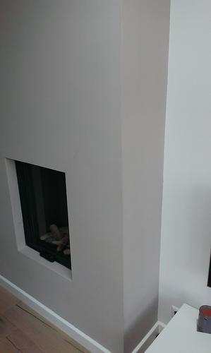 Renovlies behang aanbrengen op schouw gashaard werkspot for Glasvezelbehang sauzen