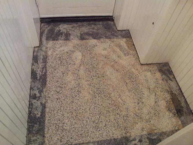 Herstellen en slijpen schoonmaken terrazzo granito vloer