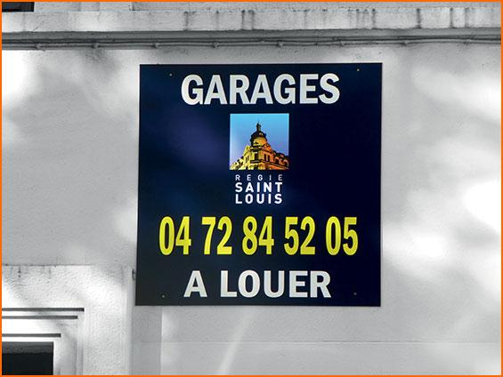 panneau immobilier de garage a louer