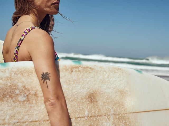 A Dermatologist Weighs In on How to Care For a Tattoo Over the Summer