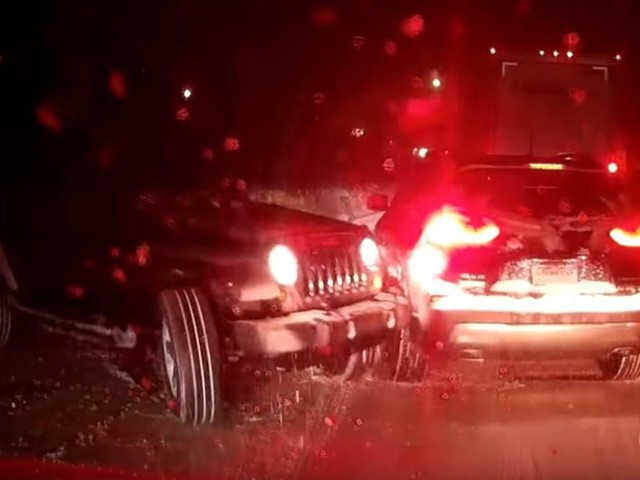 Jeep Wrangler Takes Out Cherokee In Snow Storm And Runs Away