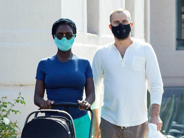 Joshua Jackson shows off a new haircut while out for a walk with Jodie Turner-Smith and their newborn baby