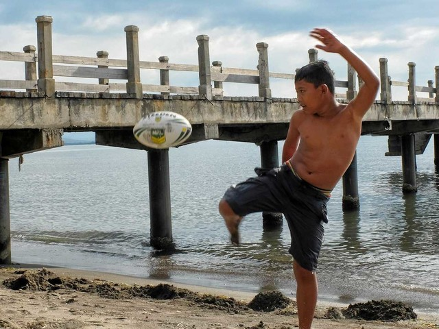 Why kids across Asia are playing with Jets' footballs