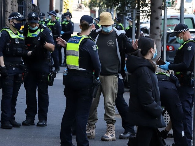 'Abusive' protesters force closure of Melbourne vaccine centre as police brace for more unrest