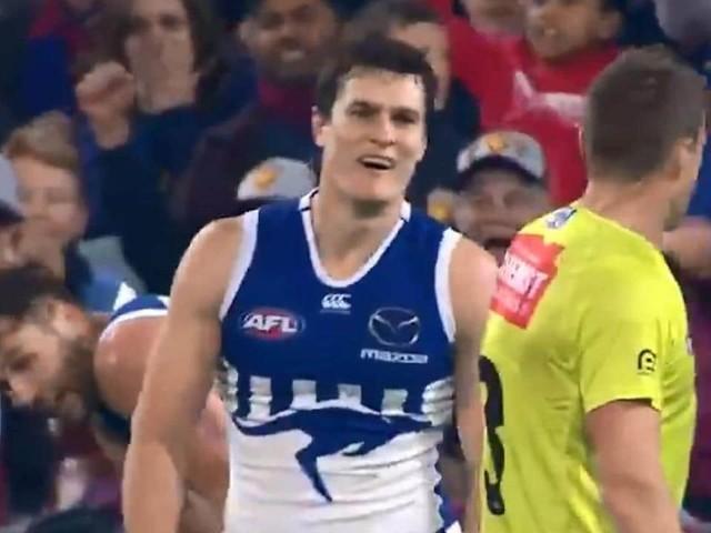 The AFL says a free kick paid against Kangaroo Scott Thompson was 'incorrect'