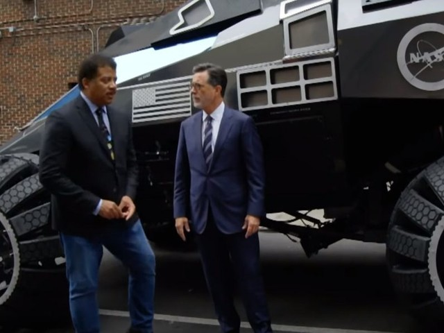 Stephen Colbert Takes A Spin In The Mars Rover Concept