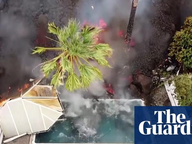 Lava fills swimming pool as La Palma eruption continues –video