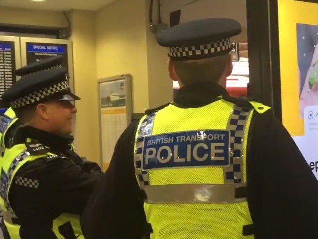 Man detained after armed police called to Woking station