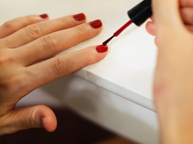 15 Red Nail Polishes That Will Get You in the Mood For Sweater Weather