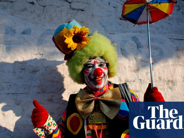Ice artwork and Clown Day: Tuesday's best photos
