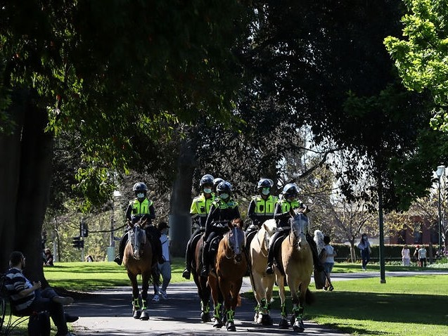 Melbourne protester in hospital with COVID-19 as police make more than 90 arrests
