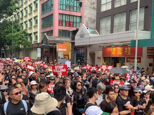 Hong Kong protesters take to streets to demand leader steps down