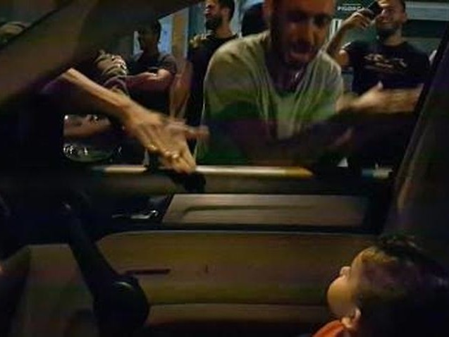Lebanese protesters sing 'Baby Shark' to soothe frightened toddler