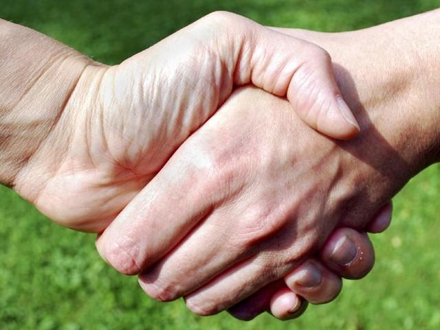 Woman claims handshake was 'violent crime'