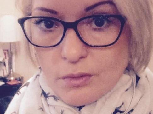 Mum 'dragged to death' into garage door