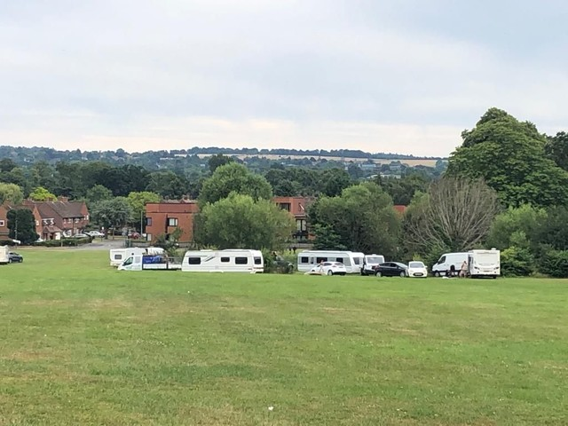Travellers descend on residential green in Guildford