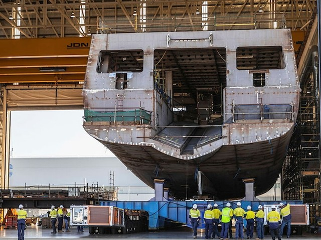 Government concedes defence ship it promised to build will now be bought from overseas